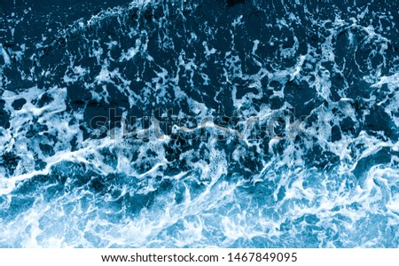 Background shot of aqua sea water waves surface. Blue ocean water and foam aerial view. #1467849095