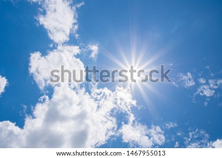 Beautiful Sunny Sky Background with White Clouds. Shining Sun at Clear Blue Sky. Summer Background with Sunlight and Clouds on Blue Sky.  #1467955013