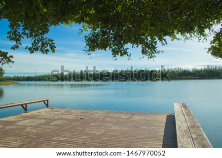 Waterfront pavilion, Waterfront pavilion and blue sky,Waterfront pavilion and Terminalia ivorensis Chev,Waterfront in the lake. #1467970052