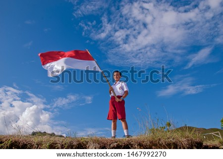 jayapura papua indonesia, poret a school child raising a red and white area, august 19 2010 #1467992270