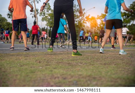 Close up  back view of Group people workout exercise with dancing a fitness dance or aerobics in the park #1467998111