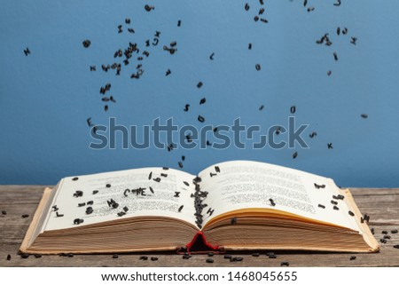 Letters fall into an old open book #1468045655