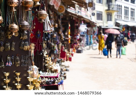 (Selective focus) Close-up view of some souvenirs (singing bowls, hand created statues and Rudraksha necklace) on a street market stall in Kathmandu Durbar Square, Kathmandu, Nepal. #1468079366