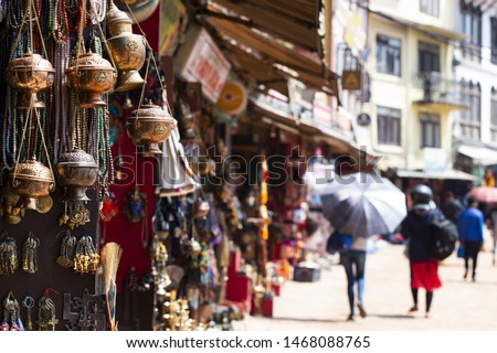 (Selective focus) Close-up view of some souvenirs (singing bowls, hand created statues and Rudraksha necklace) on a street market stall in Kathmandu Durbar Square, Kathmandu, Nepal. #1468088765