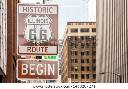 Route 66 Illinois Begin road sign at Chicago city downtown. Buildings facade background. Route 66, mother road, the classic historic roadtrip in USA #1468207271