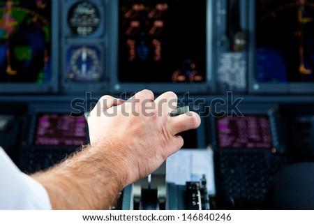 Pilot Pulling an Aircraft Throttle  #146840246