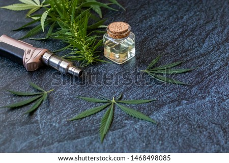 THC Oil Extract in Cartridge Close-up of Vaping Cannabis Isolated on Dark Background with Smoke #1468498085