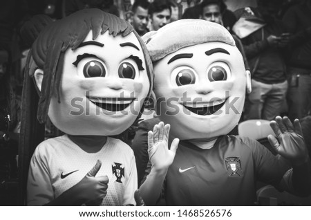 PORTO, PORTUGLAL - June 09, 2019: Portuguese fans with big doll heads during the UEFA Nations League semi Finals match between national team Portugal and Switzerland team, Portugal #1468526576