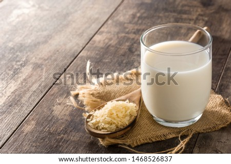 Rice milk in glass on wooden table. Copyspace #1468526837