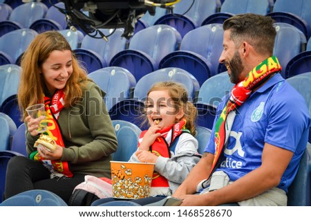 PORTO, PORTUGLAL - June 09, 2019: Portuguese fans in the stadium support their team during the UEFA Nations League semi Finals match between Portugal and Switzerland at the Dragao Stadium, Portugal #1468528670