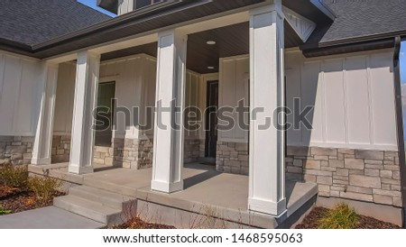 Panorama Pathway and stairs leading to the porch with pillars at the facade of a home #1468595063