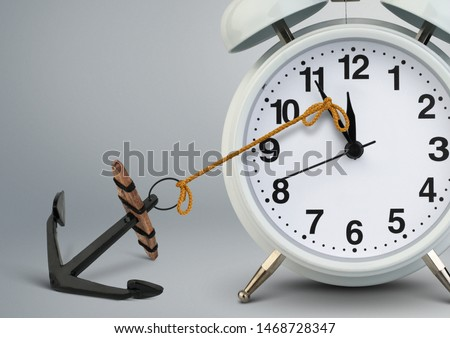 Stop time concept , clock stop by anchor Royalty-Free Stock Photo #1468728347