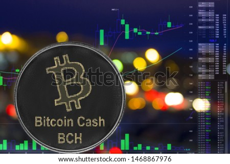 Coin cryptocurrency Bitcoin Cash on night city background and chart. BCH #1468867976