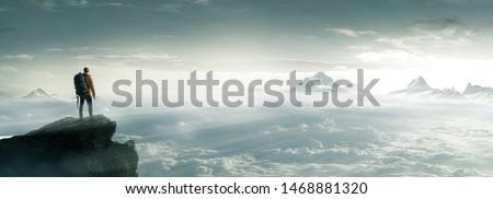Climber on a summit freedom #1468881320