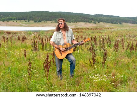 hippie musiciant young men play the guitar  #146897042