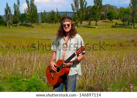 musician hippie young men with guitar on the sunny grassland #146897114