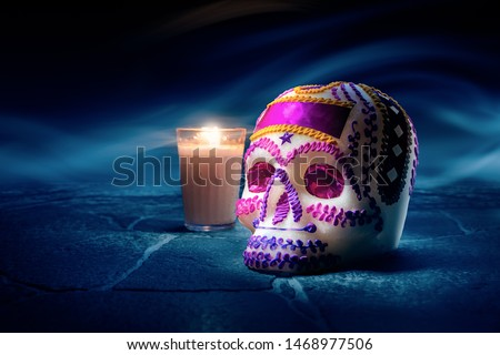 """Traditional sugar skull used at mexican offerings or """"ofrendas"""" for Day of the Dead celebration. high contrast image #1468977506"""
