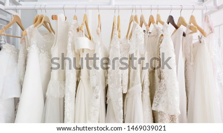 Beautiful bridal dress on hangers #1469039021
