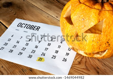 Halloween concept. October calendar with - October 31 Halloween day marked and Pumpkin - Jack-o'-lantern #1469044982