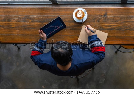 High angle view of young Asian businesspeople working on tablet  #1469059736