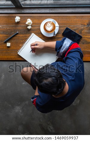 Vertical photo of Asian student using pencil drawing on sketchbook #1469059937