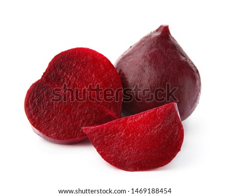 Whole and cut boiled red beets on white background #1469188454