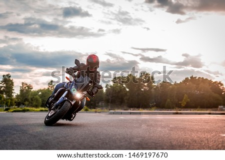 biker rides motorcycle, turns, bright colors motorcycle, sports fast motorcycle #1469197670