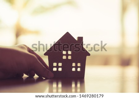 House model in home insurance broker agent 's hand or in salesman person. Real estate agent offer house, property insurance and security, affordable housing concepts #1469280179