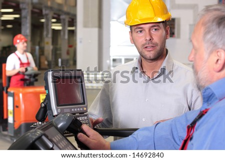 male engineer talking to forklift operator in warehouse #14692840