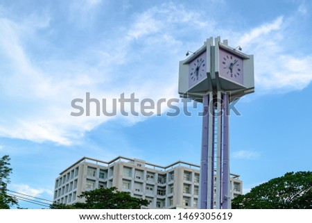 clock tower near the modern building, there are blue sky and white cloud as background, copy space #1469305619