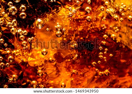 Macro soft drinks,Cola close-up,Ice, Bubble, Backgrounds, Ice Cube, Abstract Backgrounds,Ice cold drink,Detail of Cold Bubbly Carbonated Soft Drink with Ice  #1469343950