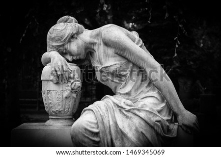 Sad and weeping woman sculpture. Sad grieving expression sculpture with sorrow face down thinking crying. Black and white BW photography.  #1469345069