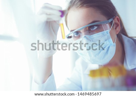 Researcher, doctor, scientist or laboratory assistant working with plastic medical tubes in modern lab or hospital. #1469485697