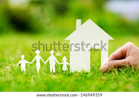 Hand hold house against green field #146949359