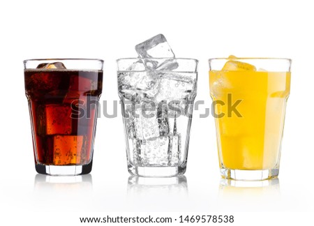 Glasses of cola and orange soda drink and lemonade sparkling water on white background with ice cubes #1469578538