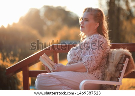 Adult woman in an autumn park on rest by day #1469587523