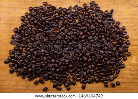 Coffee beans on a wooden table #1469604749