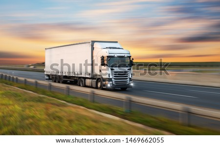 Truck with container on highway, cargo transportation concept. Shaving effect. #1469662055