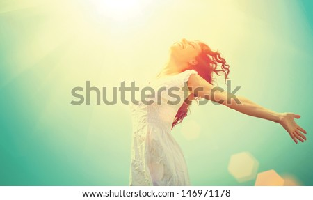 Free Happy Woman Enjoying Nature. Beauty Girl Outdoor. Freedom concept. Beauty Girl over Sky and Sun. Sunbeams. Enjoyment.   Royalty-Free Stock Photo #146971178