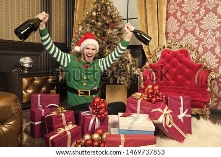 Its party night. Man enjoy christmas party. Happy man in santa costume celebrate new year holidays at christmas tree. Cheer and a happy New Year. #1469737853