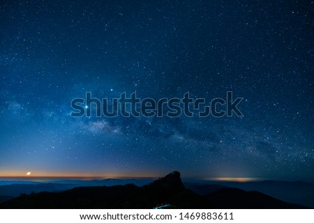 Gorgeous milky way, moon and sun in starry sky with the light of dawn at Doi Mon Jong, Chiangmai, Thailand Royalty-Free Stock Photo #1469883611