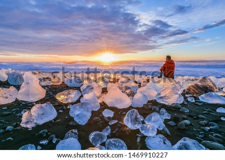 Landscape View Of The Amazing Jokulsarlon Beach (Diamond Beach) With Giant Ice Rocks On The Lava Black Beach, Shine Like Crystal Diamond Under Sunrise, Glacier Lagoon Jokulsarlon, Iceland #1469910227
