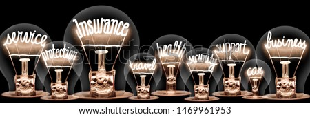 Large group of light bulbs with shining fibers in a shape of Insurance, Service, Business and Support concept related words isolated on black background #1469961953