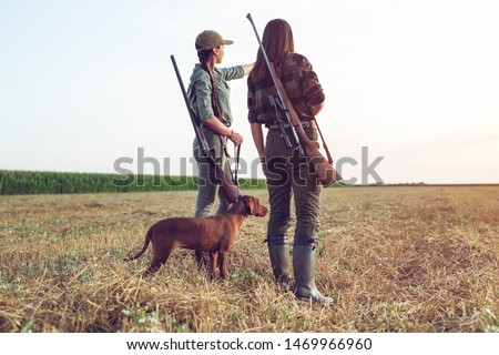 Women hunters with hunting dog  #1469966960