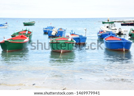 Fishing boats in a bay near the small town Polignano a Mare in Italy #1469979941