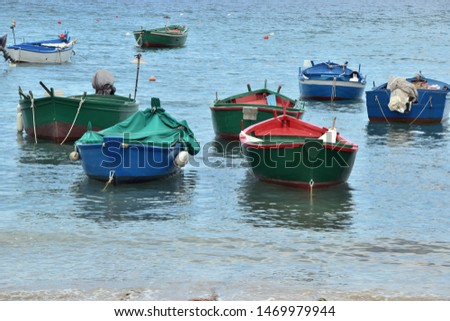 Fishing boats in a bay near the small town Polignano a Mare in Italy #1469979944