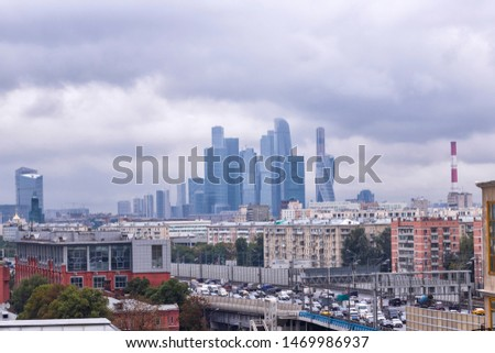 View of Moscow from Sparrow Hills (Vorobyovy Gory) at cloudy day. Translate: 3rd Ring, Kutuzovsky Avenue, Komsomolsky Avenue, Vernadsky Avenue, MKAD  #1469986937