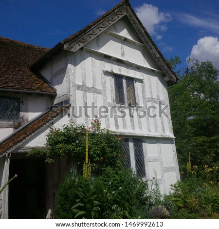 cottages and houses on a street in a village uk #1469992613