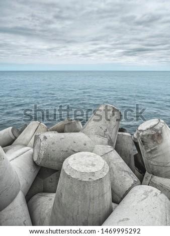 Breakwater Concrete Tetrapods. Close view of tetrapod sea defences used to prevent coastal ersosion.  #1469995292