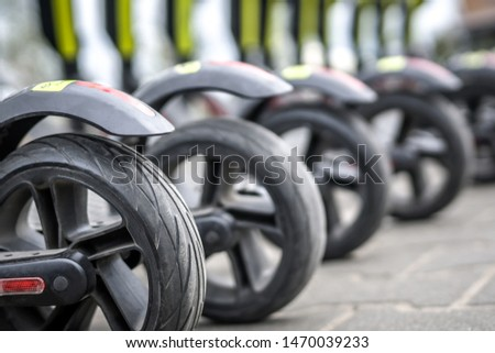 Wheels of parked electric scooters. #1470039233